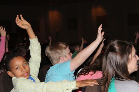 Elementary School attend play in Auditorium
